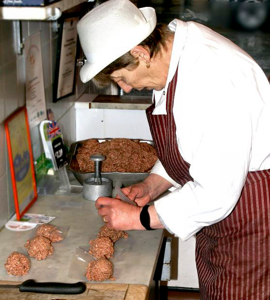 Accentric Older Woman Cooking