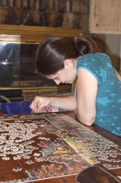 Girl Putting The Puzzle Together